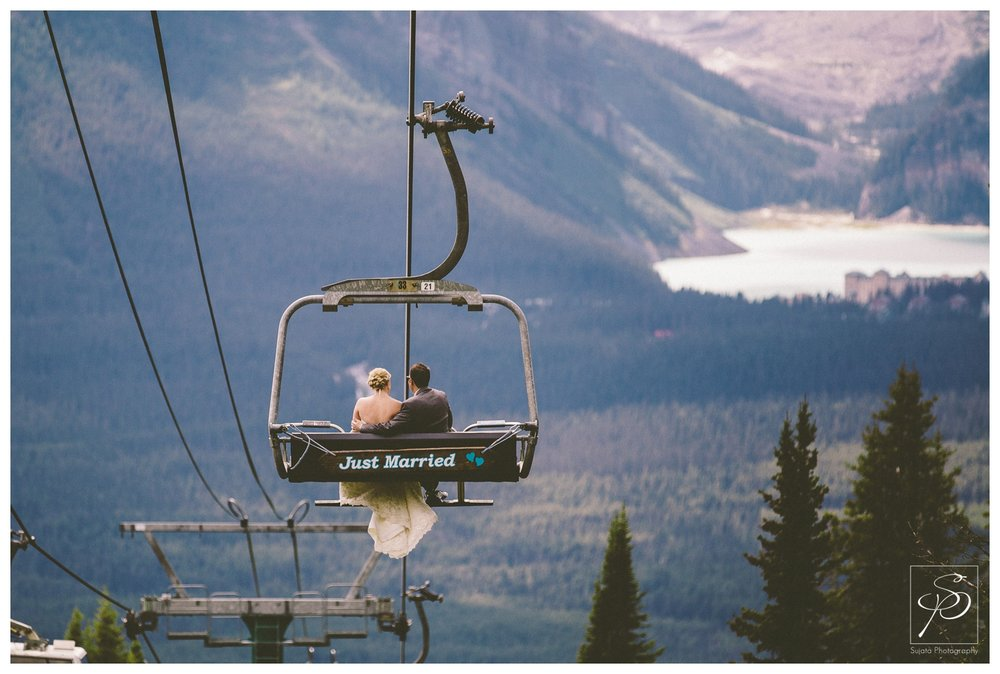 Bride and groom riding Ski lift at Lake Louise after wedding ceremony
