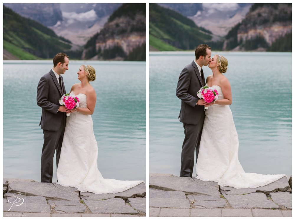 Bride and groom posing at Lake Louise in Banff