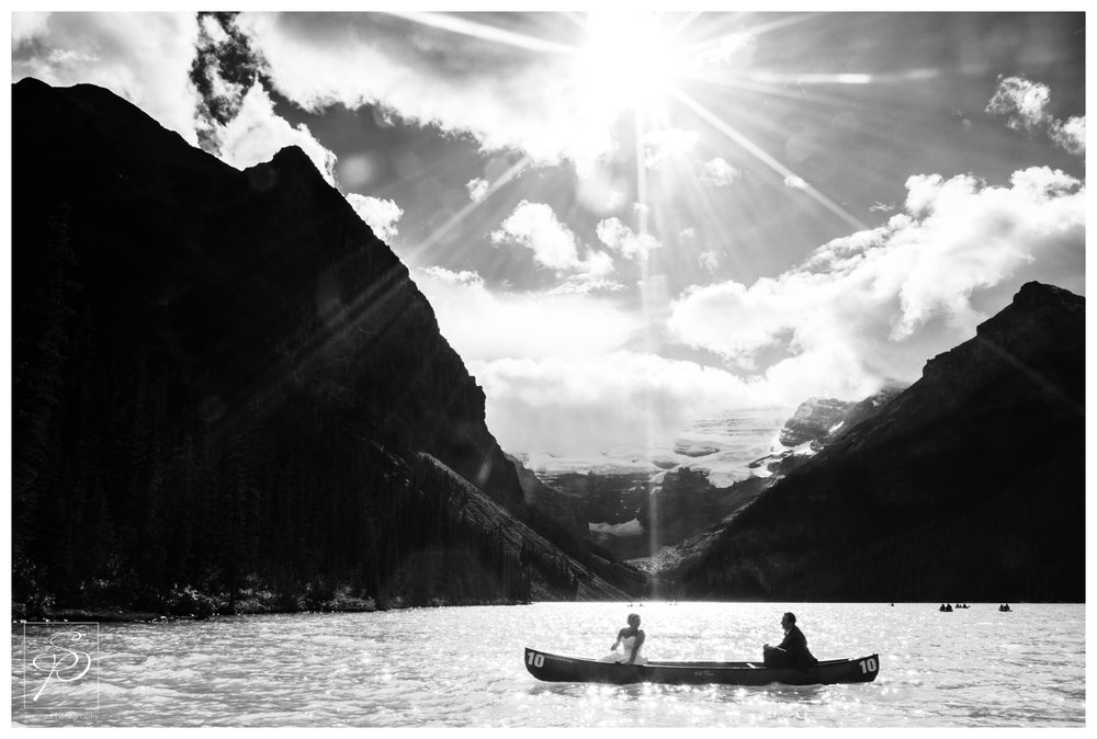Bride and Groom on a canoe ride on Lake Louise
