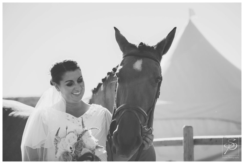 Bride with her horse at acreage wedding