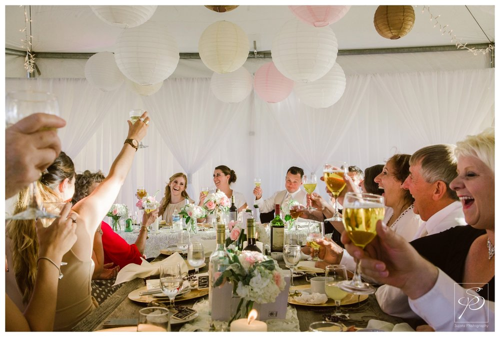 Toast to bride and groom at tent wedding reception