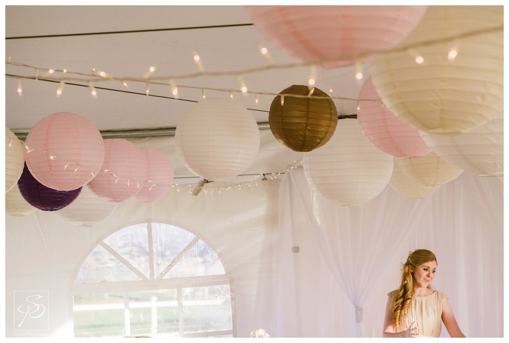 Bridesmaid giving toast paper lanterns