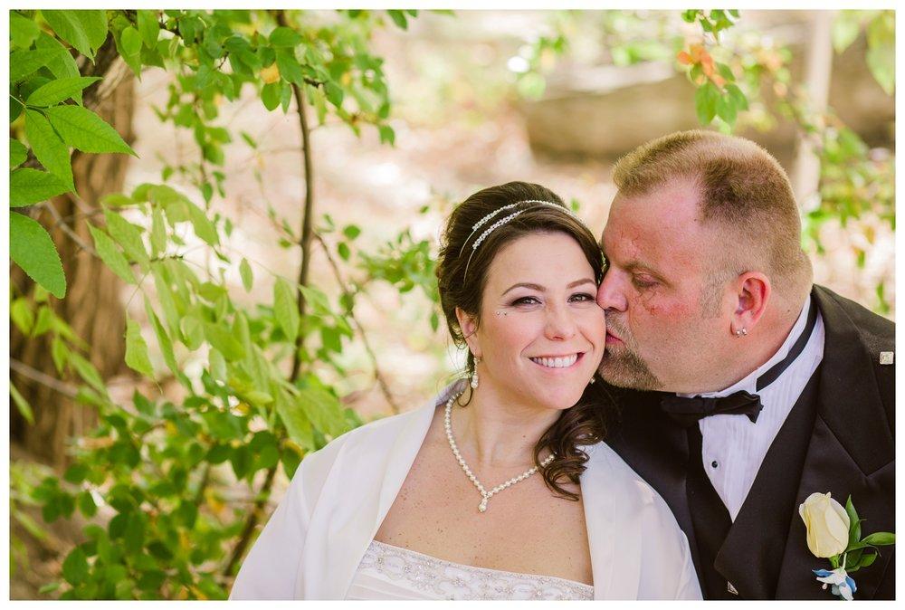 Groom kissing bride after catholic wedding ceremony