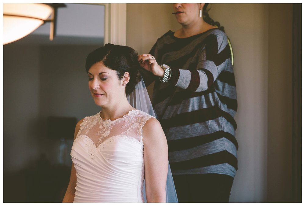 Bride getting ready for fall cathedral wedding