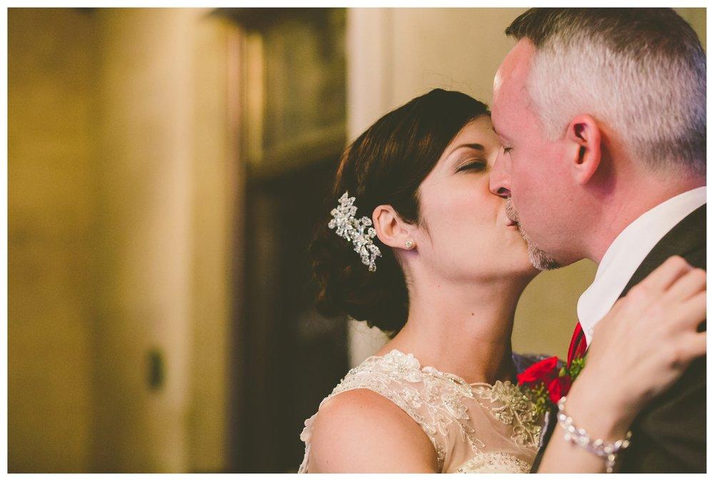 Bride and Grom kissing at Bank and Baron Pub