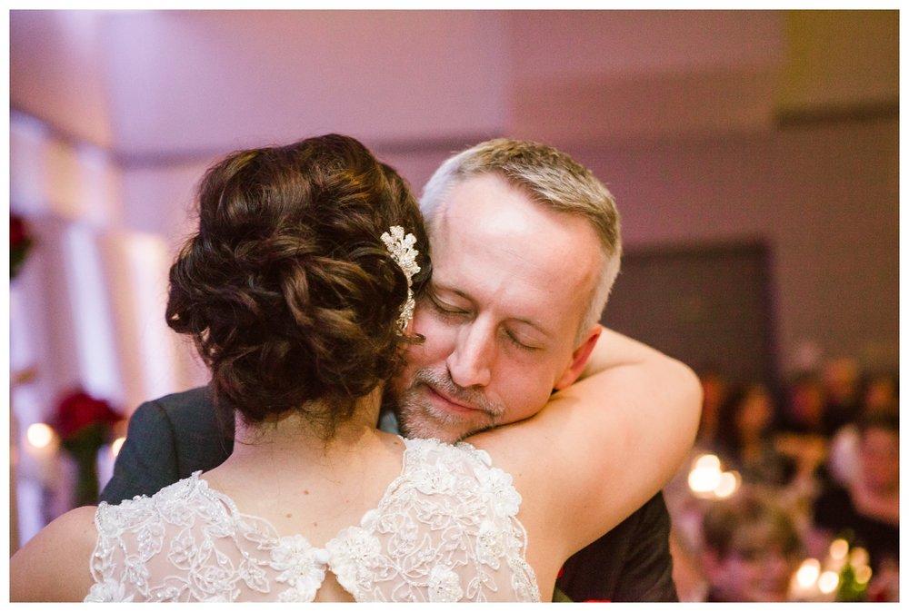 Bride and Groom hugging during wedding reception