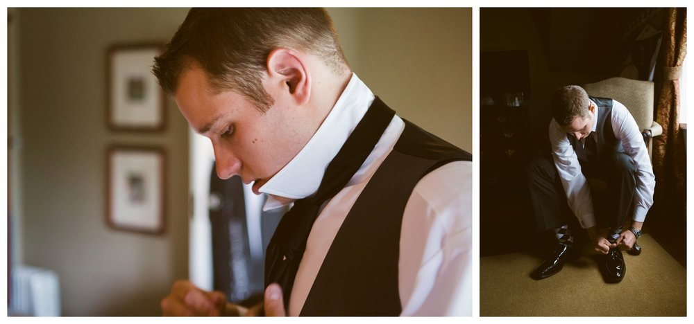 Groom putting on suit and shoes