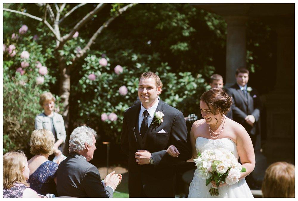 Bride and groom leaving wedding ceremony