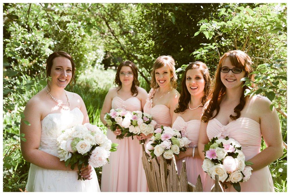 Bride with bridesmaids in garden