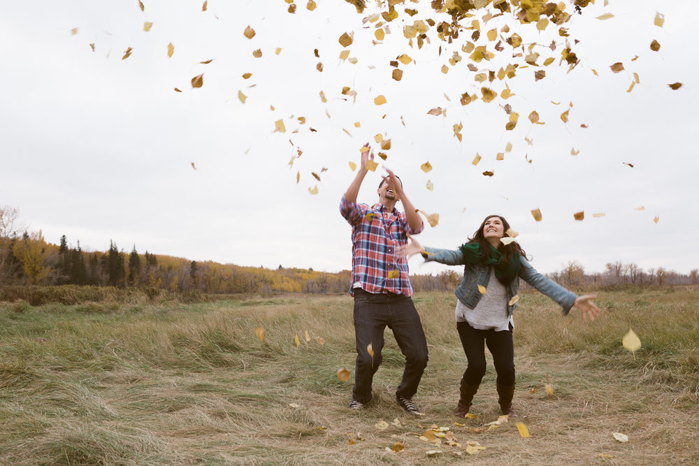 Throwing leaves Fish Creek Park