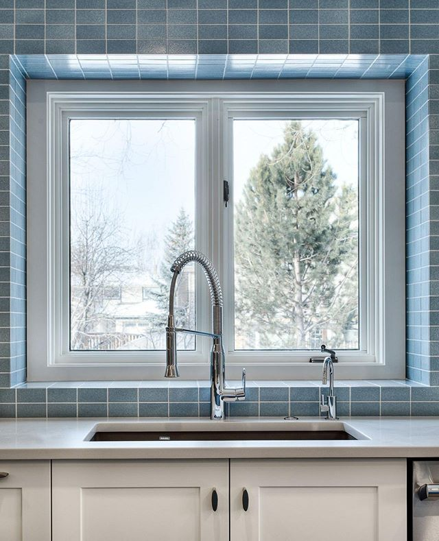 This fun blue tiled backsplash by @catalys.builds brings a great pop of colour to this bright, white kitchen.⁣ .⁣ .⁣ .⁣ ⁣  #interiordesign #kitchendesign #inspiration #renovation #yycdesign #yycliving #calgaryhomes #yychomes #yyckitchens #yycre #calgaryrealestate #realestatemarketing