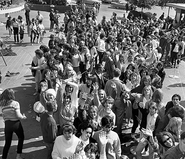 BEATLE FANS - …wait in line to buy a ticket to see the Beatles at the Hollywood Bowl in 1964. The line stretches for almost a mile.