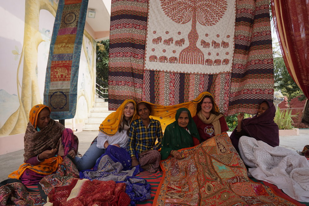 My friend, Tori, and I sat with these women for about an hour, and they were thoroughly entertained when they wrapped us in their sarees and scarves.