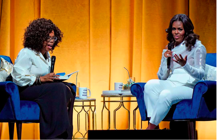Oprah Winfrey and Michelle Obama. Photo credit: Jim Young, AFP/Getty Images