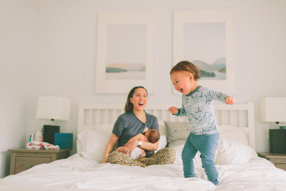 jumping-happiness-baby-family-family-mother-toddler-nursing-home-home-laughing-breastfeeding_t20_KymvOZ.jpg