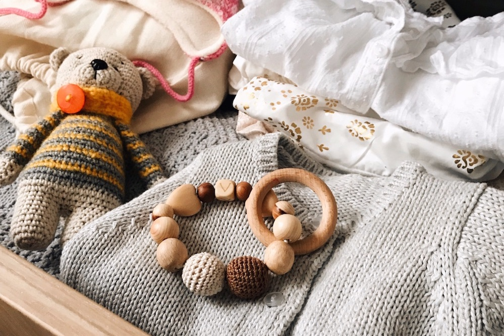 baby-stuff-and-cute-knitted-toy-of-bear-tiny-clothes-and-accessories-for-newborn-baby-girl-wooden_t20_0x1yng+copy.jpg