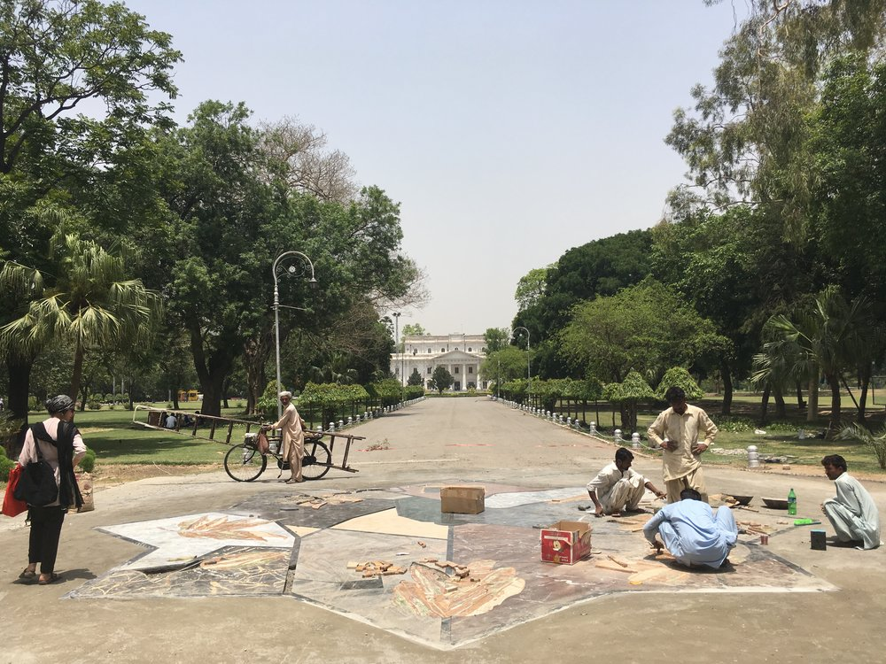 The central artwork, taking the form of an Islamic star, acts as a guide to the exploration of the gardens. Seven points of the star lead to seven non-native trees, planted by British colonisers.At each of these trees a marble stool offers a place for rest and contemplation. -