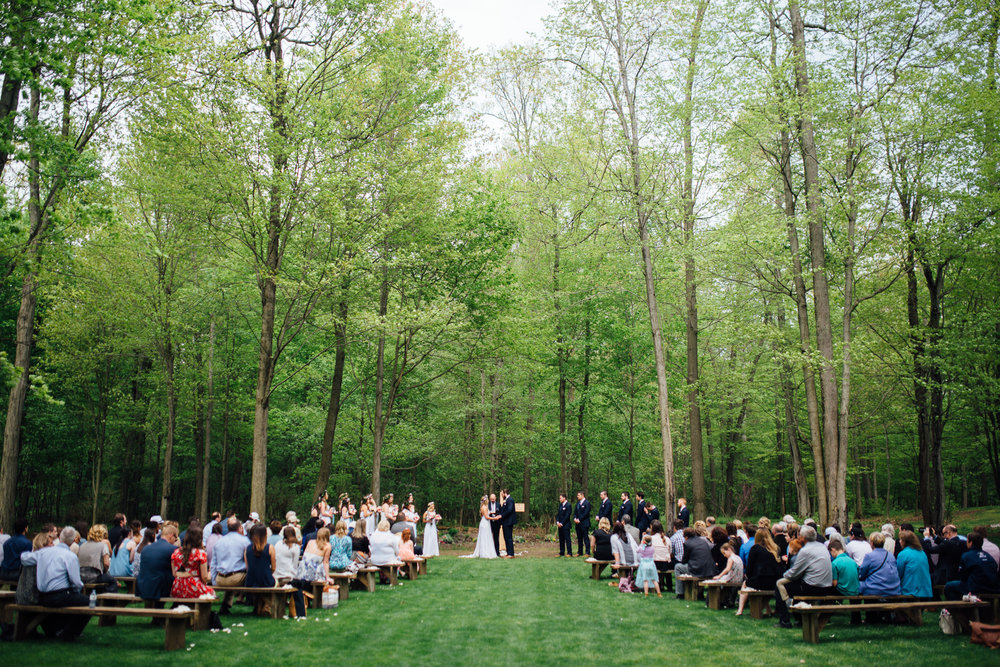 Outdoor wedding ceremony at Fernwood Hills in London, Ontario photographed by Sara Monika, Photographer.