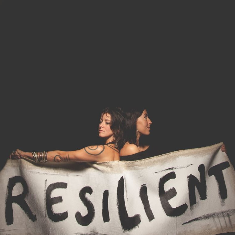 Resilient - 2018 | SingleSeeking calm in the chaos-storm that has hit America and the world at large. It's about movements. It's about getting back on your feet after being knocked down. It's about each of us finding our own pathways of strength and empowerment.Humanity is on edge. Negativity fills the air in digital waves. Division and blame define our global conversation. RESILIENT speaks in poetic honesty in hopes of inspiring a unifying, internal force in all of us to listen more and speak less. Do not silence your rage.... find your grace within.This song is so important to us. From our deep hearts to yours.#IAmResilient
