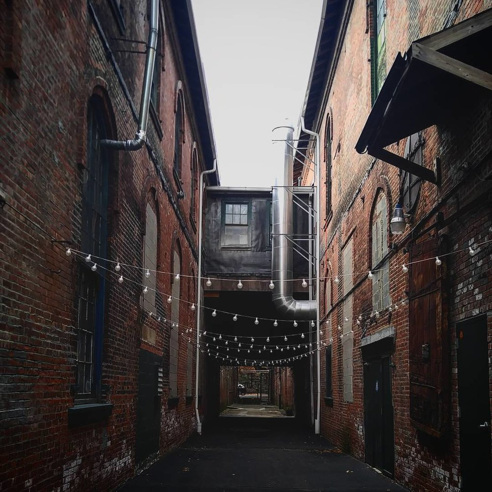 14 sprawling acres of historic brick alleys & cavernous warehouses -