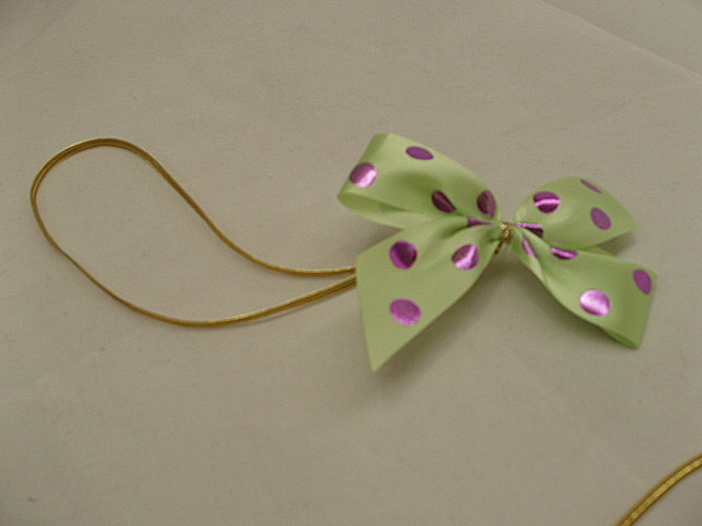 apple green fuchsia dot stretch loop bow.jpg