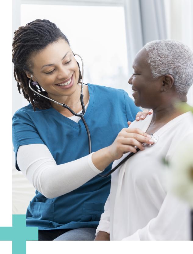 female-nurse-check-pulse-on-elderly-patient.png