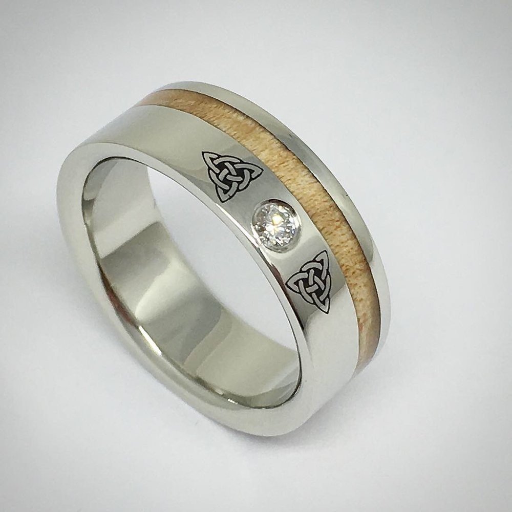 Celebrating heritage through tradition - A unique, custom design, this white gold ring was a special request that ties together the Celtic knot with maple wood and diamond.
