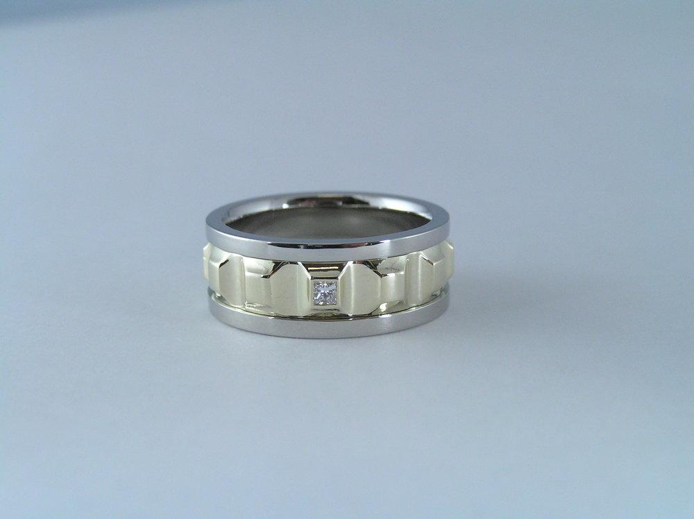 19karat white and 18karat yellow spinning ring with 3 sq.diamonds.JPG