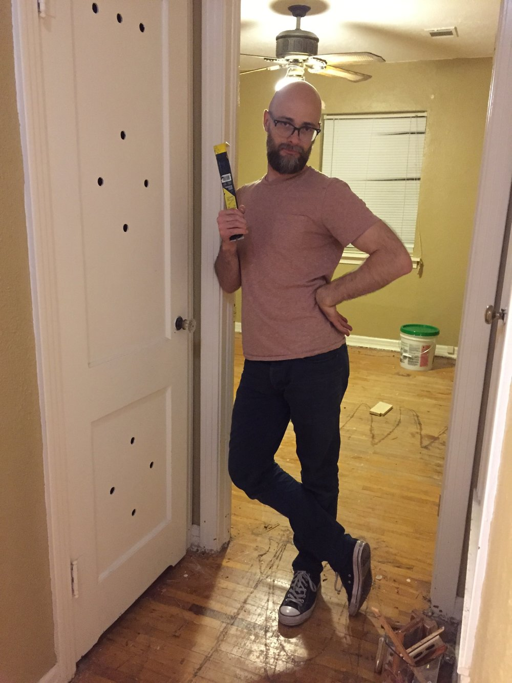 Jordan is standing in the office doorway shortly after we took possession. This creepy is-there-an-animal-in-there closet door opened into a shallow closet that held…