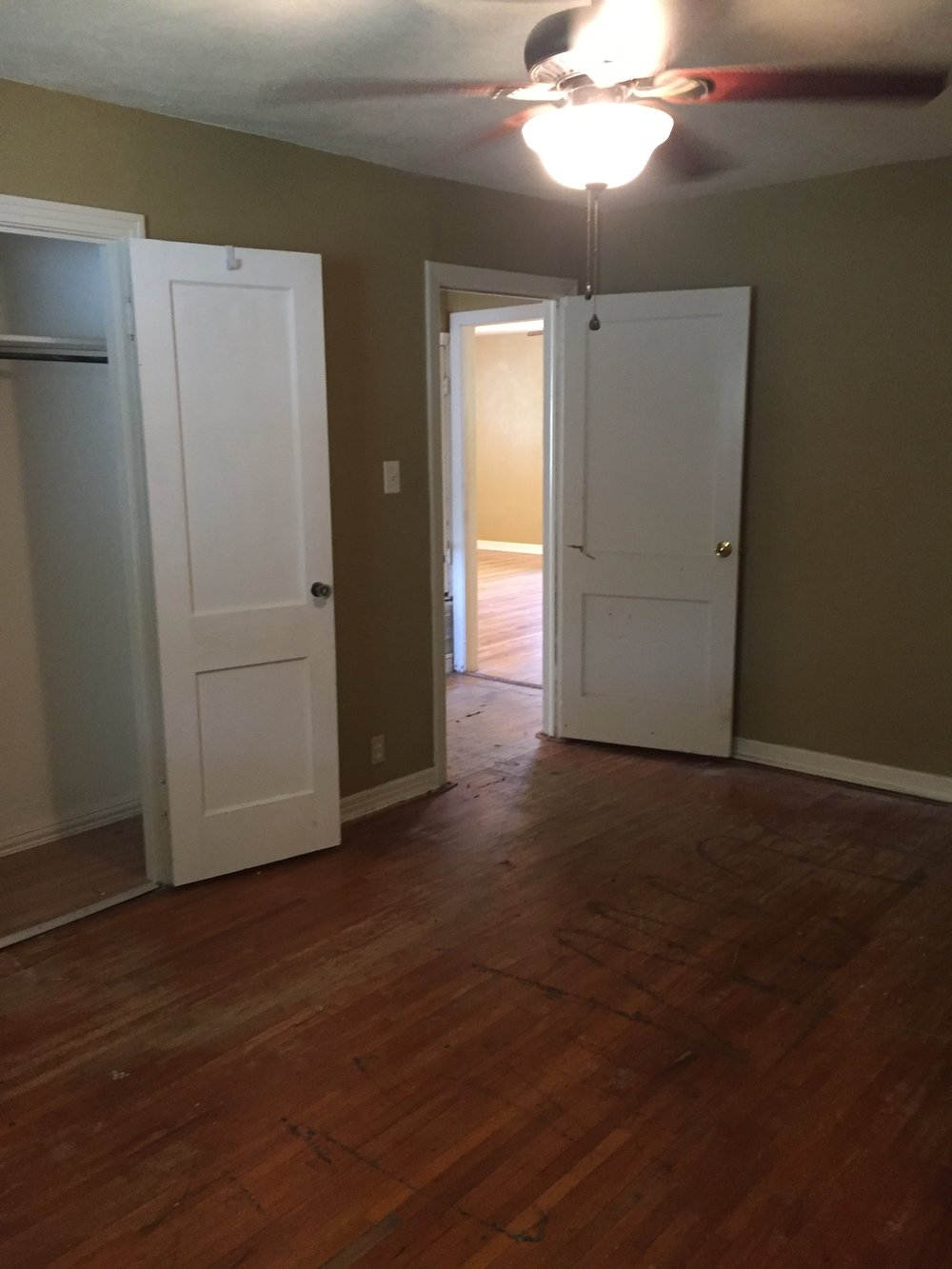 Standing in the northeast corner looking to the bedroom door (and the living room beyond) on the day we took possession. The closet is small, but I'm looking forward to finding a savvy organization strategy.