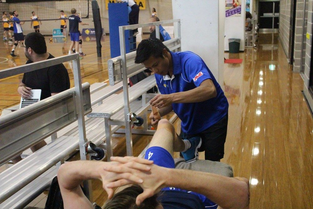 Dr Steve treating some of Australia's top athletes in the Australian Volleyball League