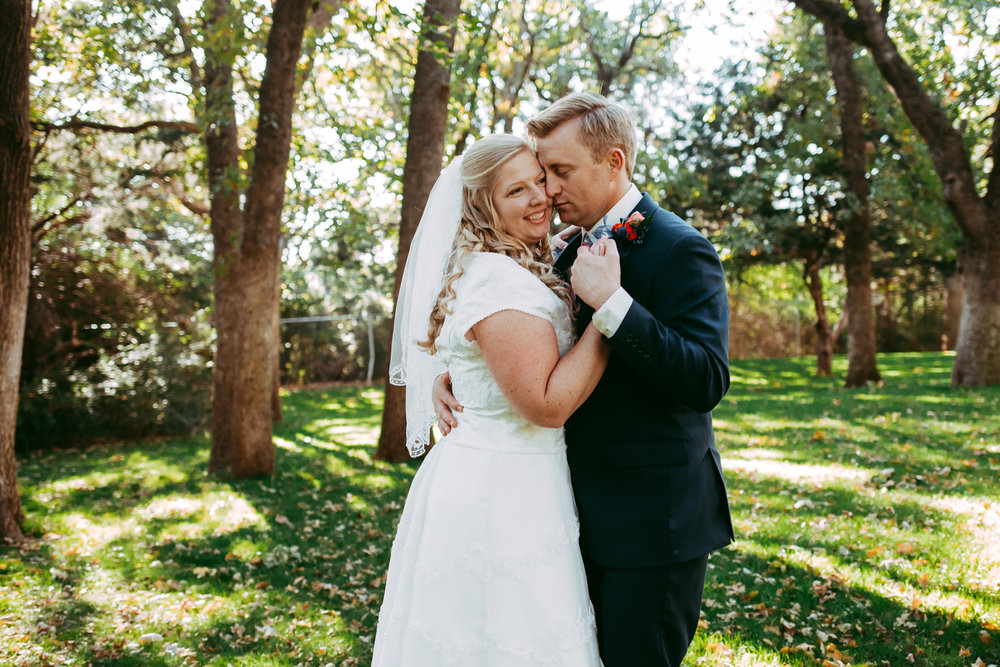 Romantic photo of bride and groom dancing outside at the Western Heritage Museum in Oklahoma City at a spring wedding by Amanda Lynn.