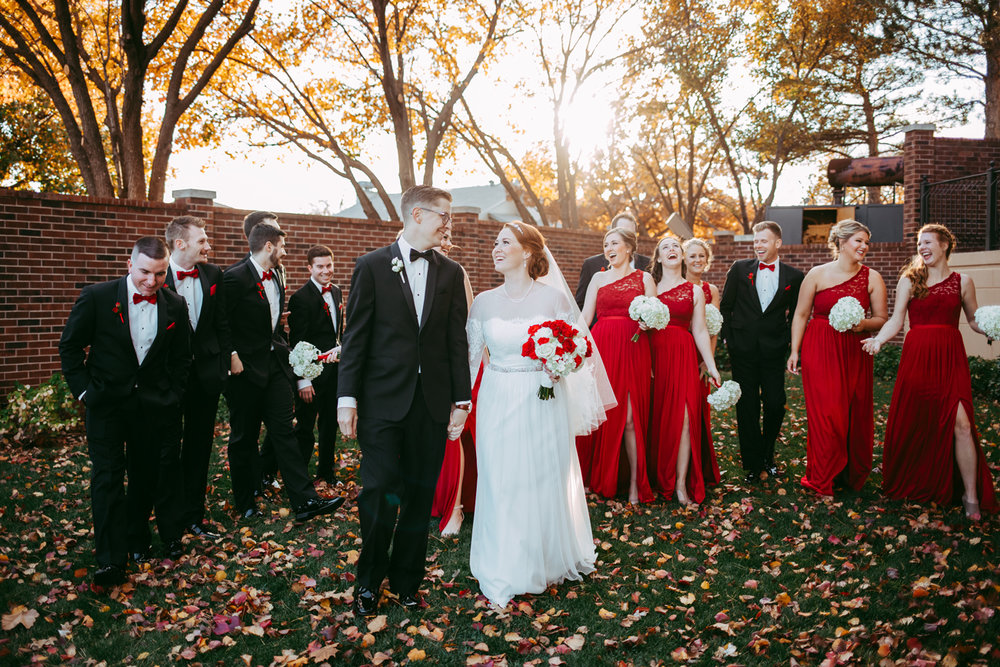 Bride and groom walking with wedding party during a fall wedding in Oklahoma.