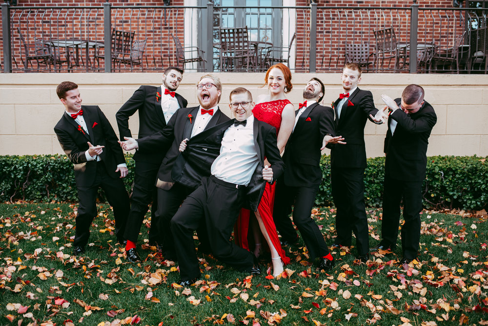 Fun photo of groom with his groomsmen all wearing bow ties at a fall wedding in Oklahoma.