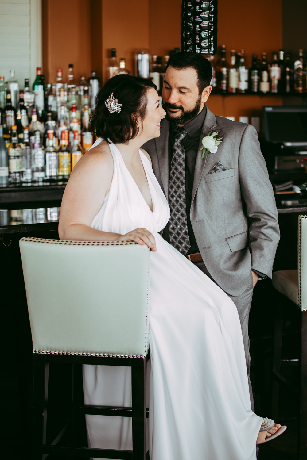 Bride and groom enjoying a moment together before the wedding ceremony at a bar in Oklahoma City.