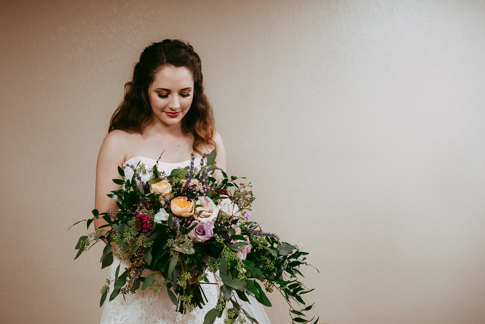Photo of oklahoma bride, holding her gorgeous bouquet of flowers before the wedding ceremony.