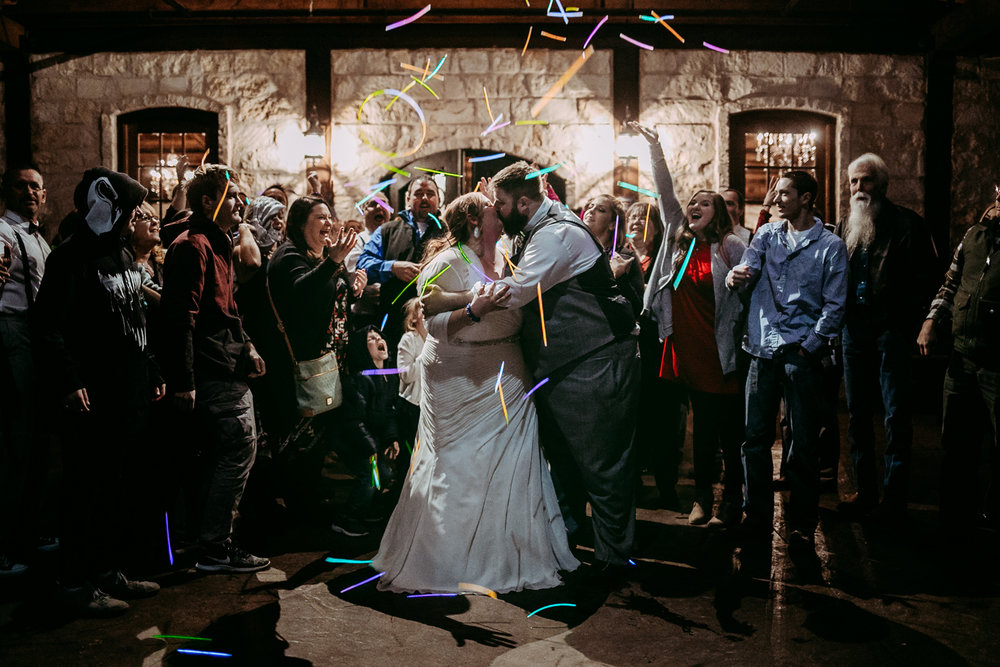Exit at a wedding with glow sticks at the Springs Event Center in Norman, Oklahoma by Amanda Lynn Weddings.