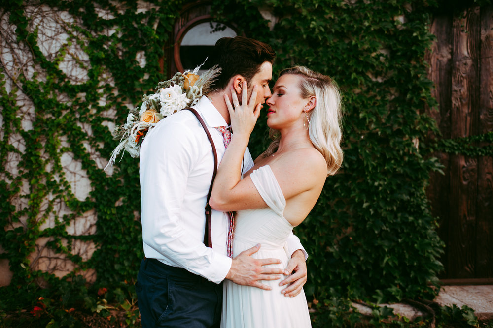 Bride and groom about to kiss on their wedding day at The Baumberhof in Oklahoma City by Amanda Lynn Weddings.