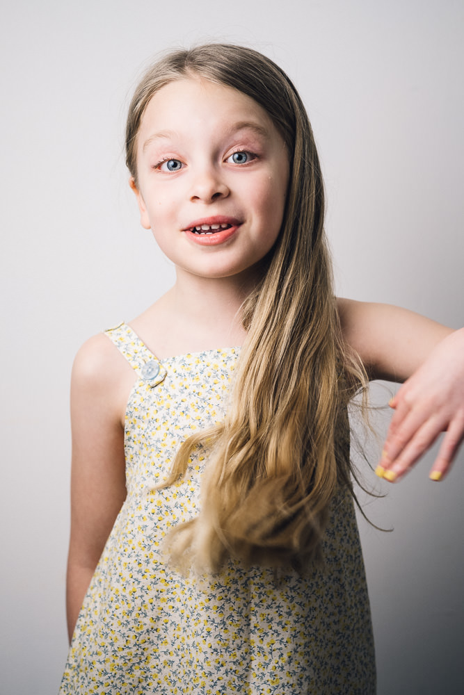 gorgeous girl with long blonde hair in a homemade summer dress www.realfamilyjourney.com