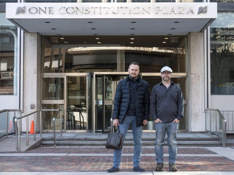 """""""I'm very fond of communal workspaces, """" says Drew Taylor, at right, CEO of AstroPrint, about the Stanley Black & Decker Inc. digital accelerator in downtown Hartford. Tayor is collaborating on a project with Dmitry Skomorokhov, director of sales, of startup Kwambio. (Patrick Raycraft)"""