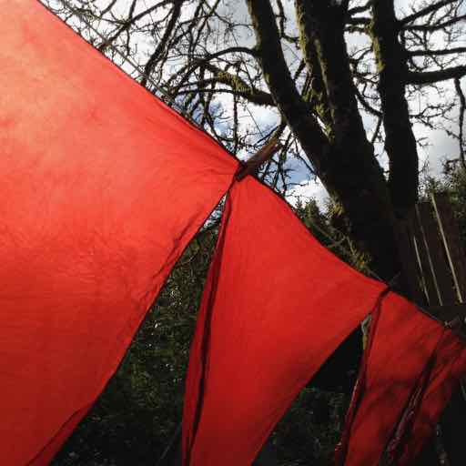 Ceremonial dyed red tent silks on the line
