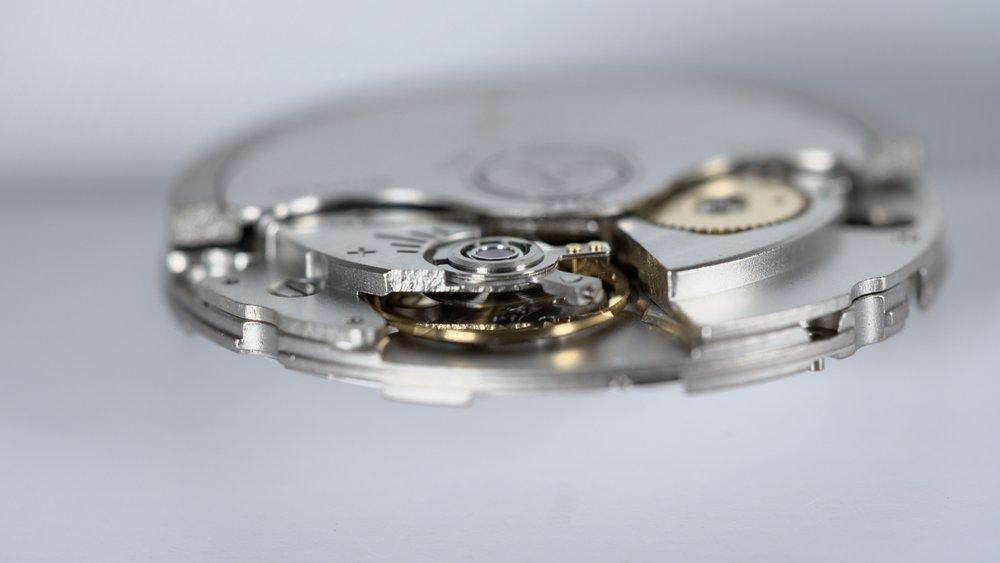 Longitude watch mechanism