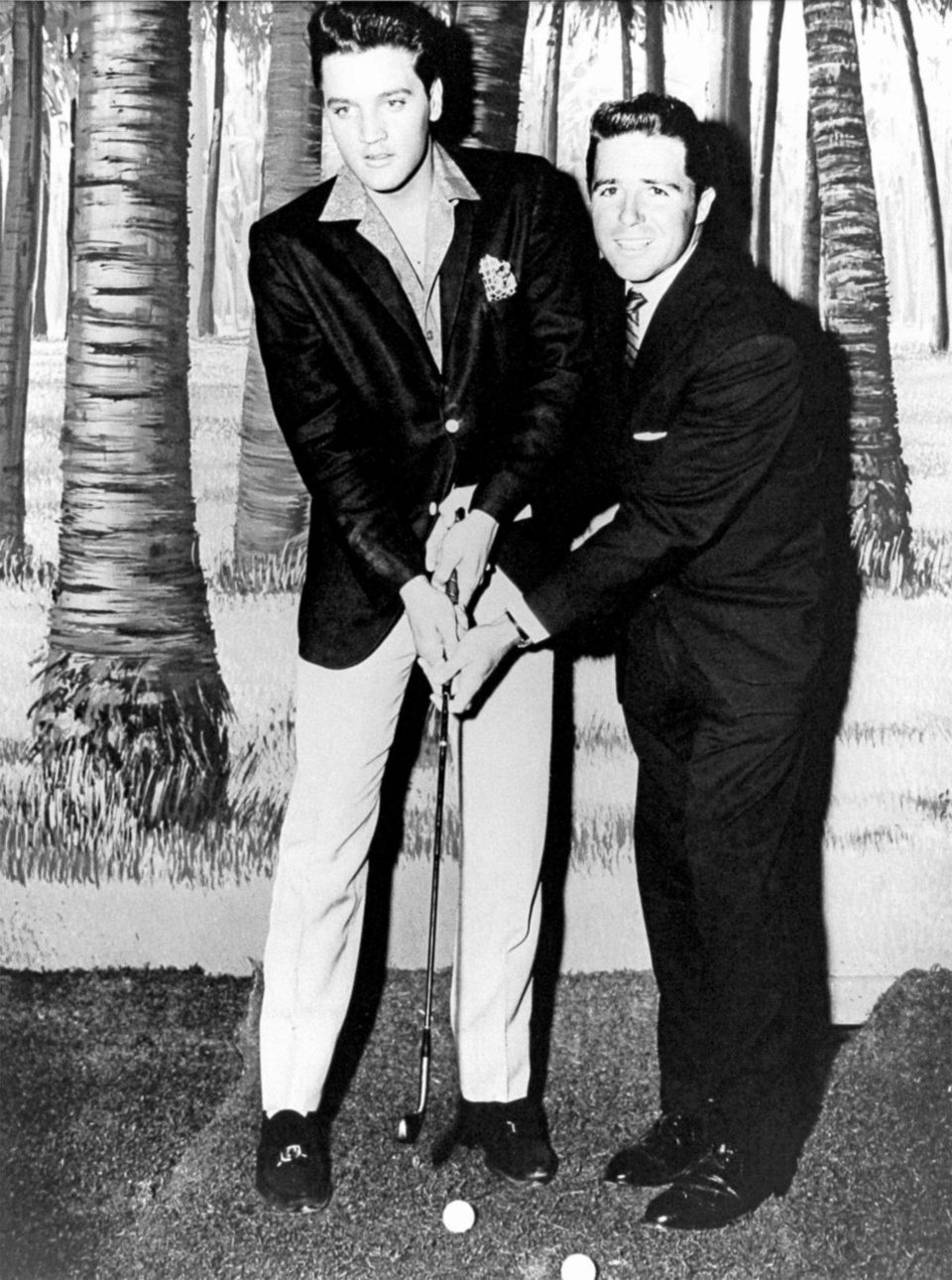 """Mr. Player gave Elvis a quick golf lesson, urging Elvis to use his hips during his swing. Elvis's response, """"The hips, Gary? You're talking to the right man!""""  IMAGE COURTESY OF BLACK KNIGHT ARCHIVES"""