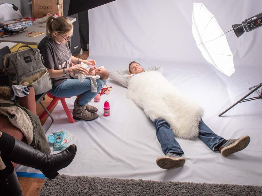 Jono taking a rest between photo sets while baby Isaac gets a change