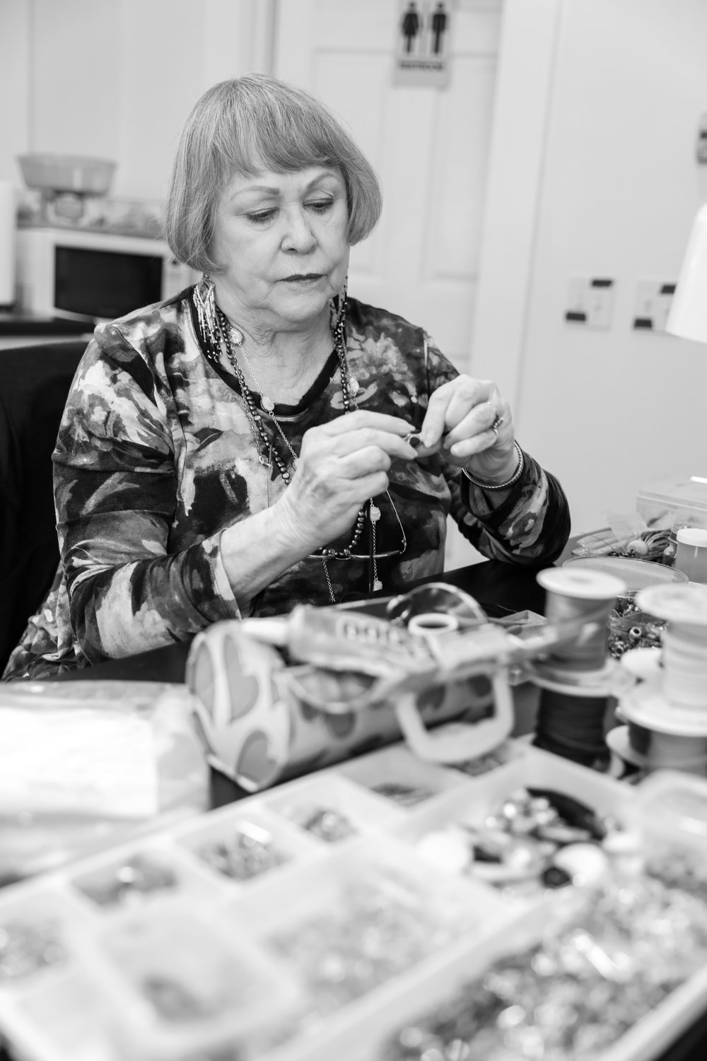 Patsy Roberts working on a strap for a purse. Photo credit Kelly Strawinski.jpeg