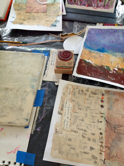 Photo of gelli plate and monoprints in process