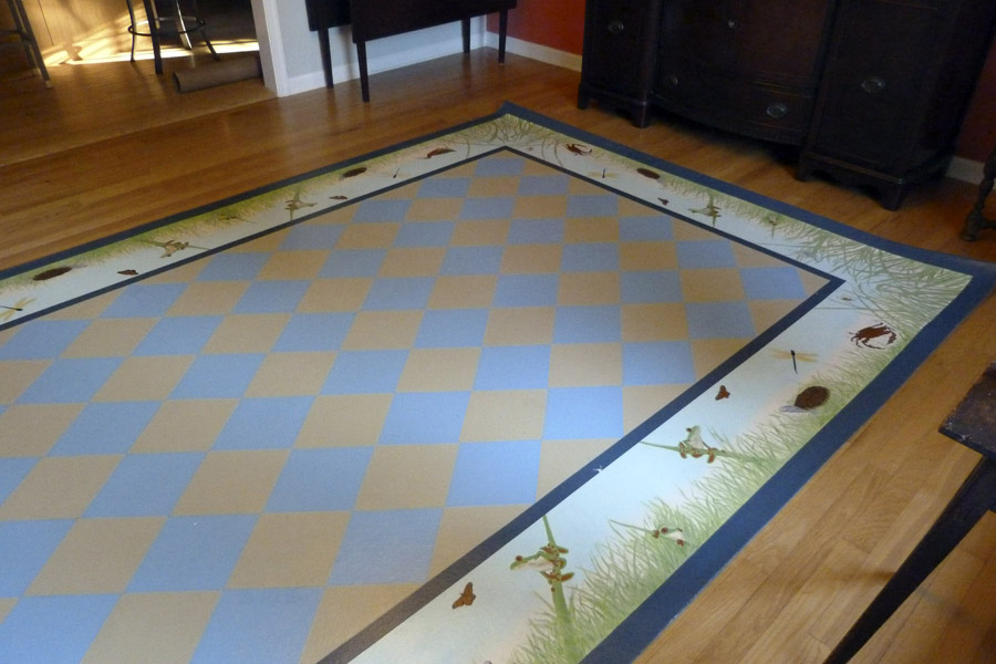 Install of painted floorcloth with diamonds in center and marsh animals and grasses in border
