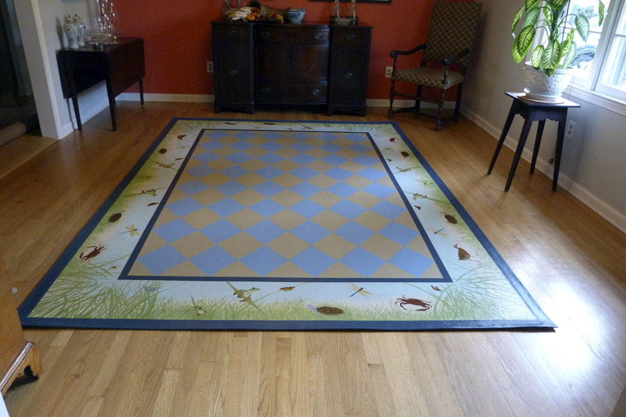 Commissioned floorcloth - 7.5' x 10.5'. Traditional diamonds in center with marsh animals in border.