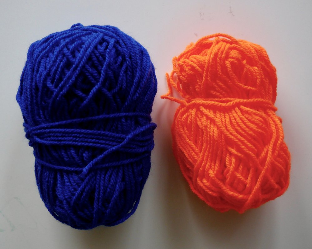 Complementary colors, blue and orange.