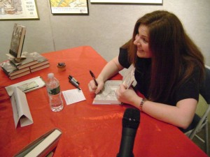 Signing some books (notice the cupcake I have saved for a treat for when I finished!)